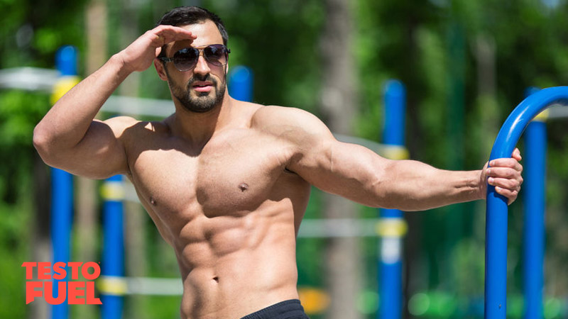 Strong, muscular bodybuilder with high testosterone levels training bodyweight in the park