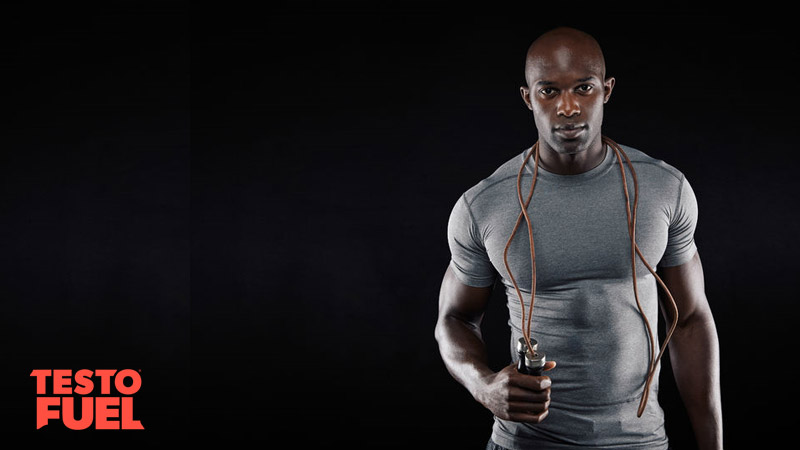 Muscular man with big biceps and shoulders with skipping rope