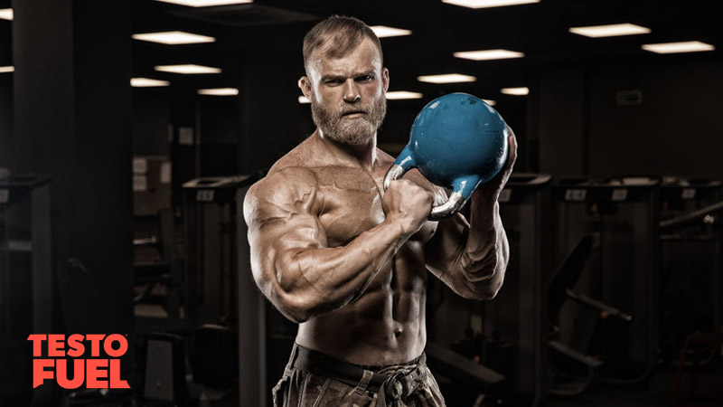 Muscular man with testosterone booster and kettlebell