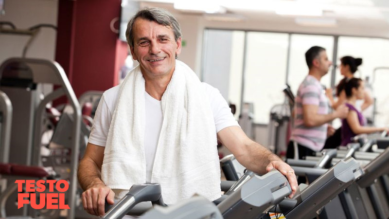 Older man with hypogonadism training in the gym