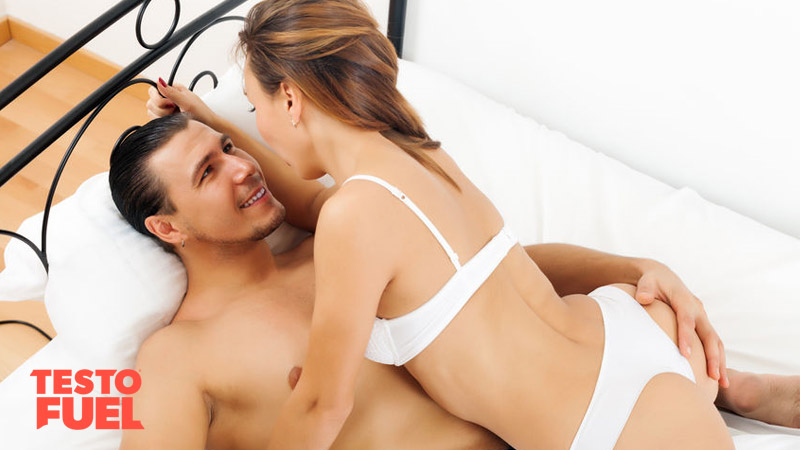 Man and a woman intimate in bed sex