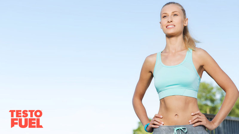 Young blonde-haired woman in sportswear outside exercising